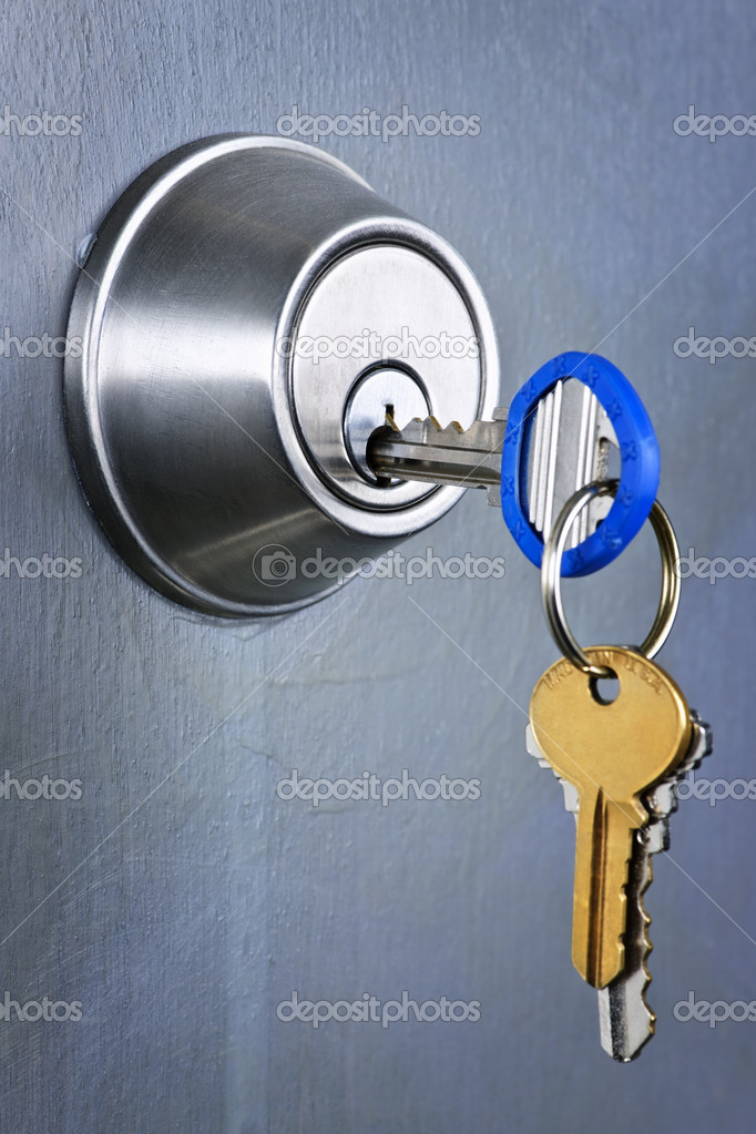 Keys inserted in door lock close up — Stock Photo #6696672