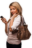 Standing pretty women with mobile phone, isolated on white — Stock Photo