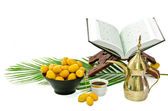 The Holy Quran and Arabic Coffee with date fruit — Stock Photo