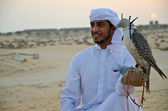 Arab Man carrying Falcon — Stock Photo