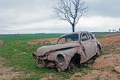 Abandoned car — Photo