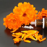 Globules and marigold — Stock Photo