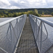 Bridge spanning over a lake - Stock Photo
