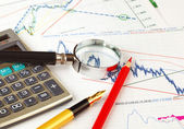 Graphs and charts on the table — Stock Photo