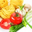 Pasta on the table and ingredients from vegetables — Stock Photo #5630476