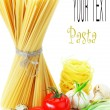 Pasta on the table and ingredients from vegetables — Stock Photo #5630480