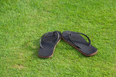 Slippers on grass — Stock Photo