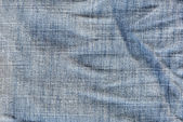 Abstract background crumpled jeans. — Stock Photo