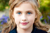 Portrait of a pretty little girl — Stock Photo