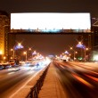 Stock Photo: Light billboard on night street of Sankt-Petersburg