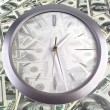 Stock Photo: Clock on 100 dollar banknotes