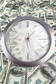 Clock on the 100 dollar banknotes — Stock Photo