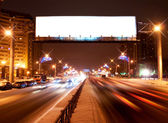 Light billboard on the night street of Sankt-Petersburg — Stock Photo