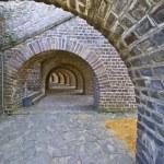 Beautiful old brick arcades surrounding the amphitheater in Xanten — Stock Photo #5903831