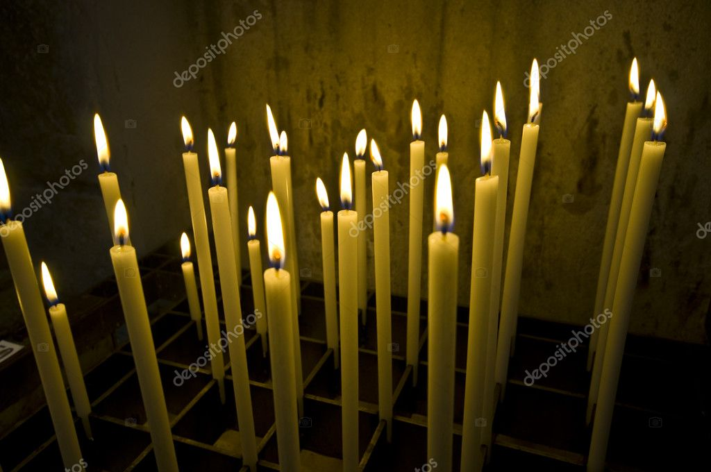 A bunch of long candles in an old dark church   Stock Photo #6590505