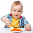 Cute little boy is playing with carrot salad — Stock Photo #5414413