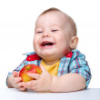 Little child is eating red apple and smile — Stock Photo #5414447
