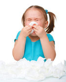 Little girl blows her nose — Stock Photo