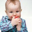 Little child is eating red apple — Stock Photo