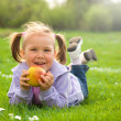 Stock Photo: Little girl is laying on green meadow