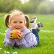 Little girl is laying on green meadow — Stock Photo