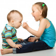 Sister is feeding her little brother — Stock Photo #5575304
