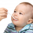 Little boy is being feed by his mother — Stock Photo