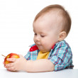 Little child is eating red apple — Stock Photo #5624223
