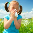 Little girl is blowing her nose — Stock Photo #5627462