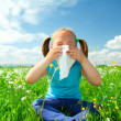 Little girl is blowing her nose — 图库照片