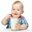 Cute little boy is holding big glass of milk — Stock Photo