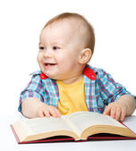 Little child play with book — Stock Photo