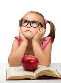 Little girl is sitting bored with a book — Stock Photo