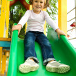 Cute little girl is playing on slider — Stock Photo #6234471