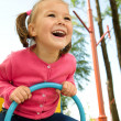 Cute little girl is swinging on see-saw — Stock Photo #6234480