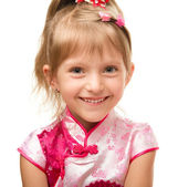 Cute little girl in pink dress — Stock Photo