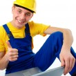 Young construction worker showing good sign — Stock Photo
