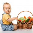Cute little boy with basket full of vegetables — Stock Photo #6290100