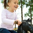 Cute little girl is swinging on see-saw — Stock Photo #6290128