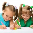 Two little girls draw with markers — Stock Photo #6290482