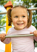 Little girl is playing in playground — Stock Photo