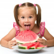Stock Photo: Cute little girl is going to eat watermelon