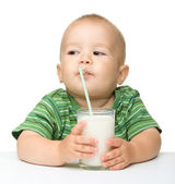 Cute little boy is drinking milk — Stock Photo