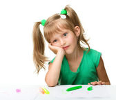 Cute little girl is tired with drawing — Stock Photo