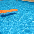 Stock Photo: Inflatable mattress in pool