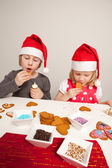 Girls decorating gingerbread cookies — Stock Photo