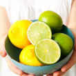 Woman with lemon and lime — Stock Photo