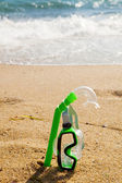 Snorkel and mask in sand — Stock Photo