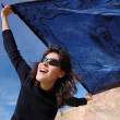 Stock Photo: Girl with a blue shawl.
