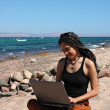 Girl with laptop on a beach — Stock Photo #5448112
